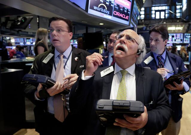 Peter Tuchman, foreground right, works with fellow traders on the floor of the New York Stock Exchange, Monday, Aug. 24, 2015