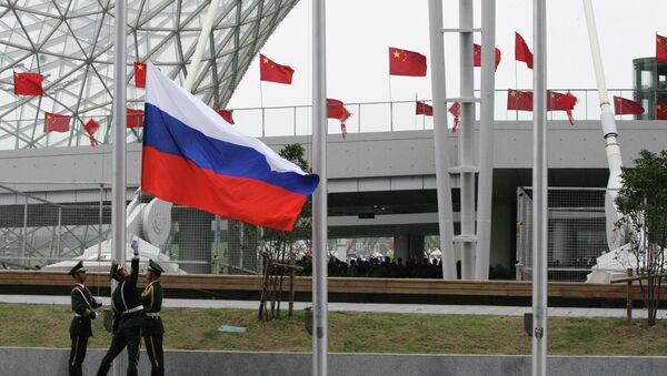 Hoisting the Russian flag during the opening ceremony of Russia Day at Shanghai World Expo.File photo - Sputnik International