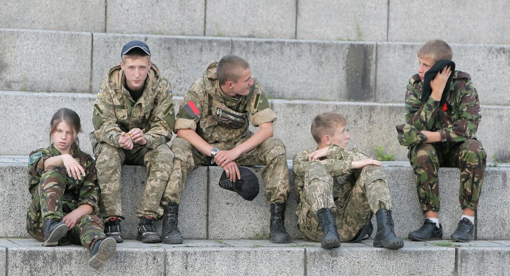 Members of the Right Sector group rest prior their rally in the center Kiev, Ukraine, Tuesday, July 21, 2015