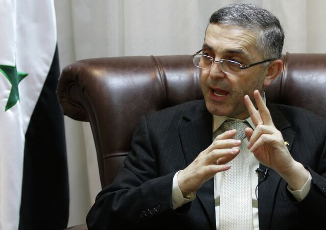 Syrian Reconciliation Minister Ali Haidar speaks during an interview with AFP in Damascus on February 11, 2014