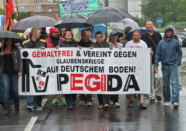 Participants of a rally called 'Patriotic Europeans against the Islamization of the West' (PEGIDA) demonstrate in Chemnitz, eastern Germany, Monday, Aug. 17, 2015
