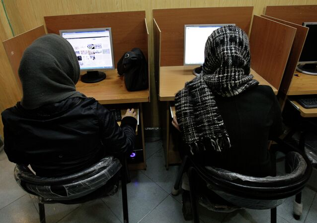 Iranian women use computers at an Internet cafe in central Tehran, Iran