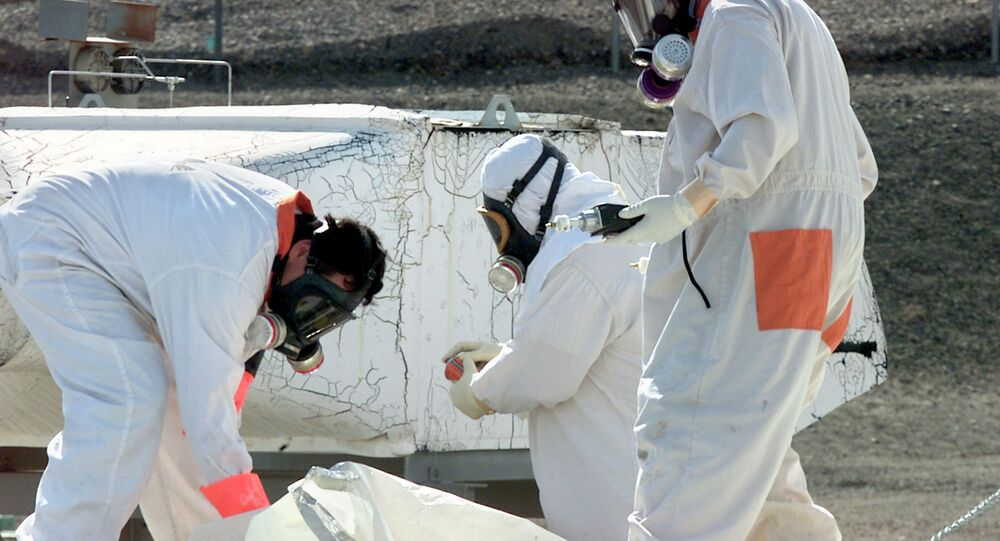 Workers at the Hanford Nuclear Reservation near Richland, Washton, measure for radiation and the presence of toxic vapors in March 2004.
