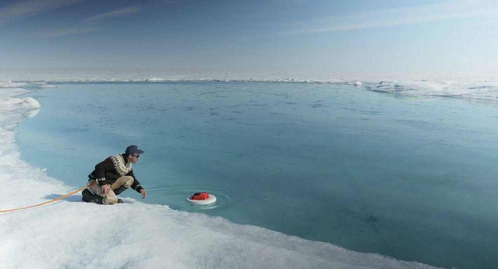 Laurence C. Smith, Chair of Geography at University of California, Los Angeles, deployed an autonomous drifter in a meltwater river on the surface of the Greenland ice sheet on July 19, 2015.