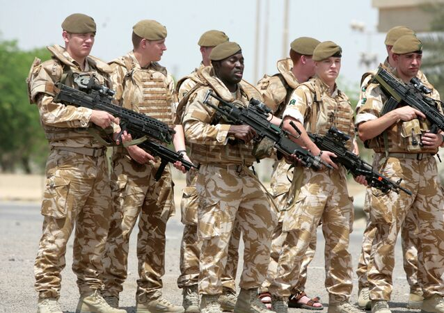 British soldiers pose for a photograph along the parade ground in Baghdad's fortified Green Zone. File photo