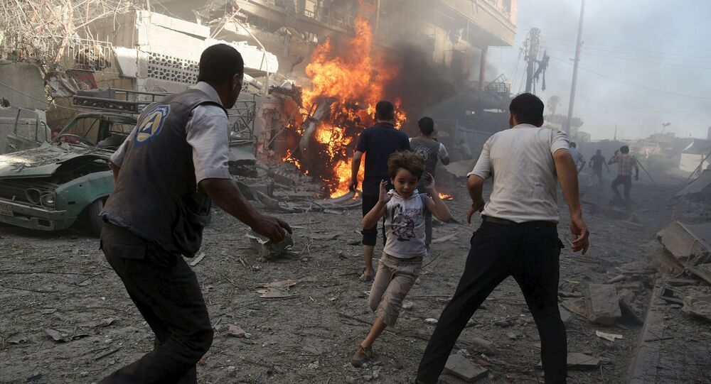 A boy runs as he rushes away from a site hit by what activists said were airstrikes by forces loyal to Syria's President Bashar al-Assad in the Douma neighborhood of Damascus, Syria August 24, 2015