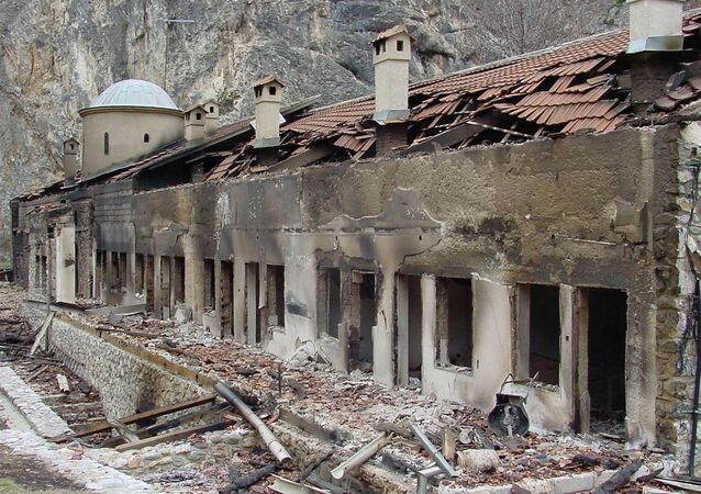 A general view shows the burned facade of the Serbian Orthodox monastery Sveti Arhandjeli in the southwestern Kosovar village of Prizren 23 March 2004