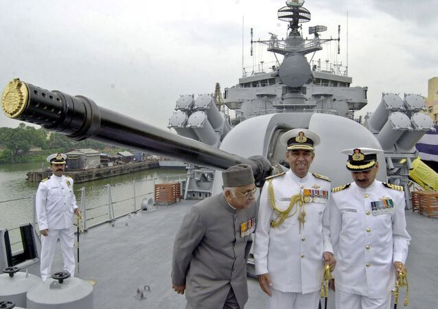 India Navy officers stand on the deck of INS Betwa in Calcutta, India, in July 2004.