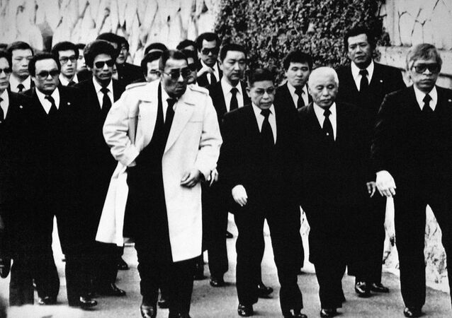 Top members of the Yamaguchi-gumi Japan's largest Yakuza Organization, arrive for the funeral in Kobe, western Japan on Dec. 16, 1988, for their boss Masahisa Takenaka, who was killed by a splinter group's gunman in February 1985. Soon after Takenaka's death the gang went to a war to avenge the murder, which has left 25 dead and 70 injured by police count, now seems to be nearing an end.