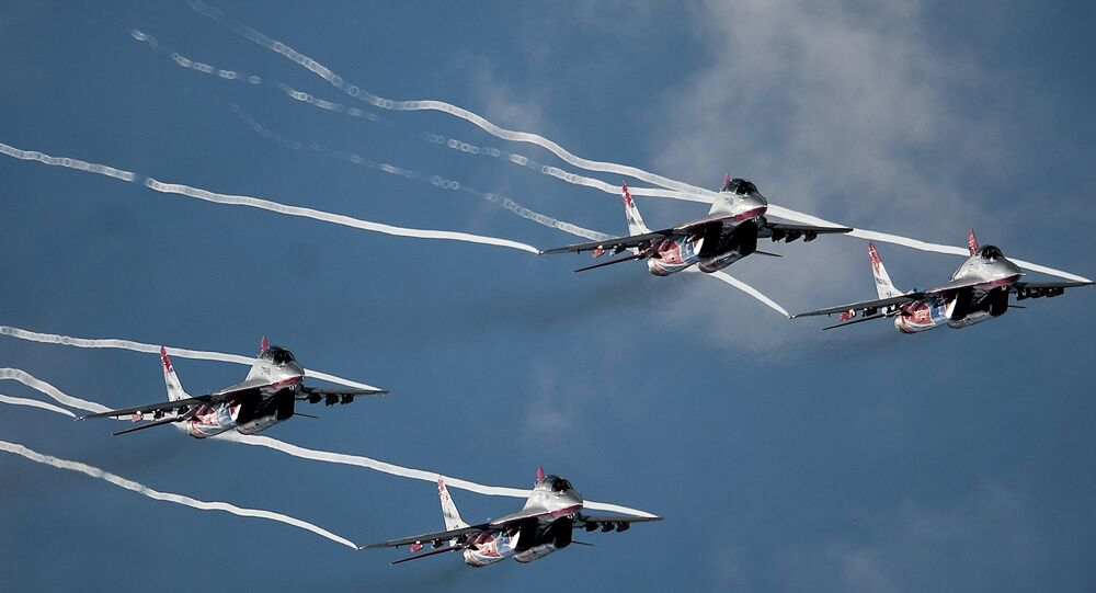 The Strizhi aerobatic team performs at the MAKS 2015 International Aviation and Space Salon in Zhukovsky outside Moscow