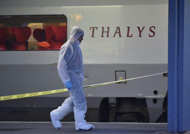 Police walk on a platform next to a Thalys train of French national railway operator SNCF at the main train station in Arras, northern France, on August 21, 2015