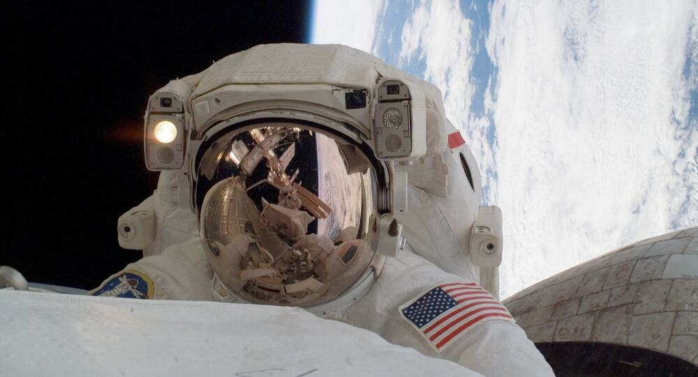 Astronaut Rick Linnehan, STS-123 mission specialist, participates in the mission's first scheduled session of extravehicular activity (EVA) as construction and maintenance continue on the International Space Station.