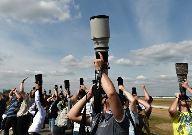 Photo correspondents at the MAKS 2015 International Aviation and Space Salon in Zhukovsky outside Moscow.