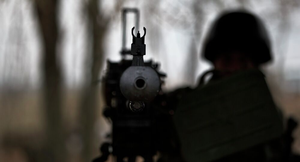 A soldier mans a heavy machine-gun position at a Ukrainian army checkpoint.