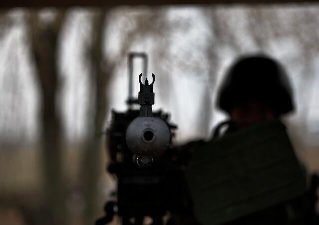 A soldier mans a heavy machine-gun position at a Ukrainian army checkpoint.