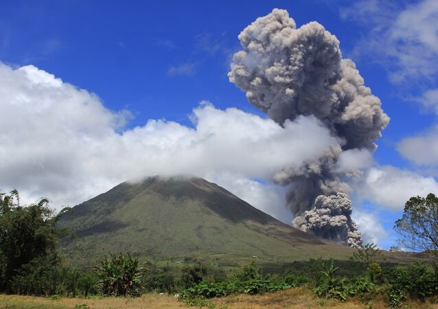 The Lokon volcano spewing hot smoke in the air.