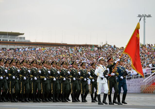 Soldiers of China's People's Liberation Army (PLA) march during a rehearsal for a military parade in Beijing