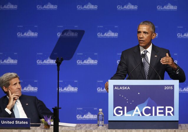 U.S. President Barack Obama is flanked by Secretary of State John Kerry as he delivers remarks to the GLACIER Conference at the Dena'ina Civic and Convention Center in Anchorage, Alaska August 31, 2015