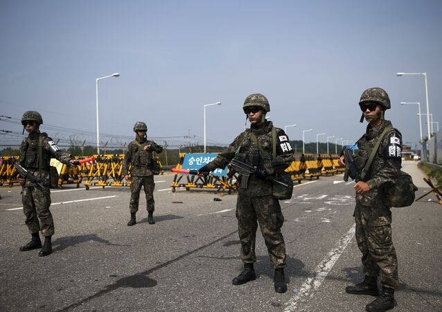South Korean soldiers stand guard at a checkpoint on the Grand Unification Bridge which leads to the truce village Panmunjom, just south of the demilitarized zone separating the two Koreas, in Paju, South Korea, August 24, 2015