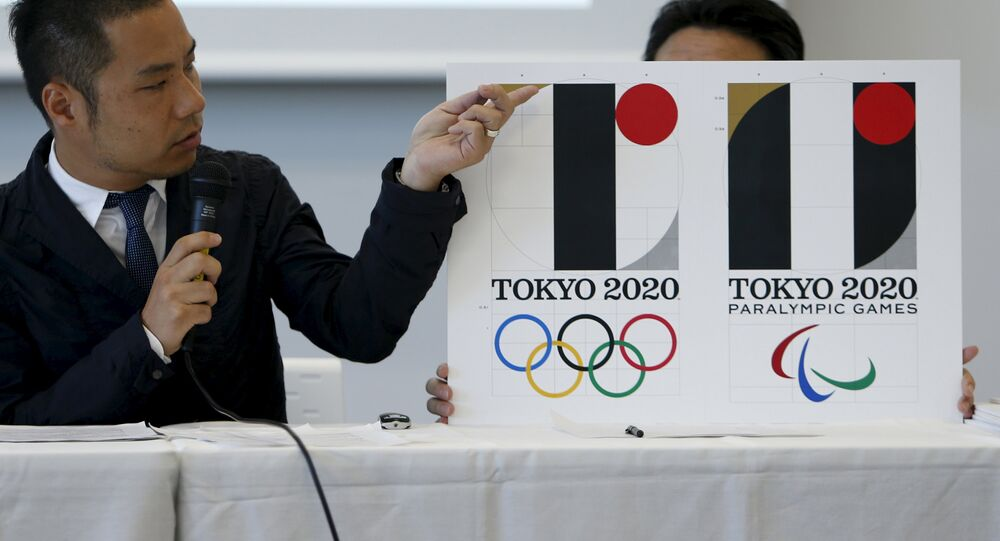 Kenjiro Sano, designer of Tokyo 2020 Olympic and Paralympic Games logos, explains about the designs during a news conference in Tokyo, Japan, August 5, 2015