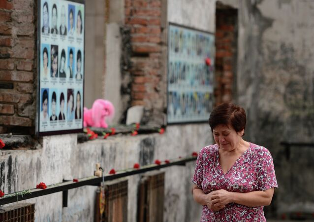 A woman cries at a commemorative event marking 10 years since the Beslan school siege at the memorial to the victims of the terrorist attack on September 1, 2004.