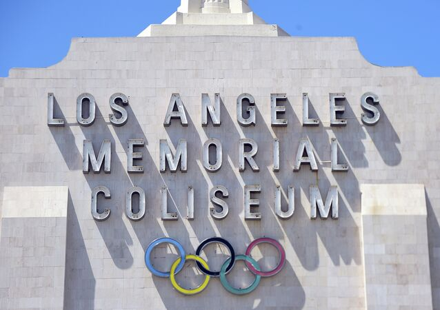 A worker manouevers is vehicle past an entrance to the Los Angeles Coliseum, which played host to the 1932 and 1984 Summer Olympics, in Los Angeles, California on August 31, 2015