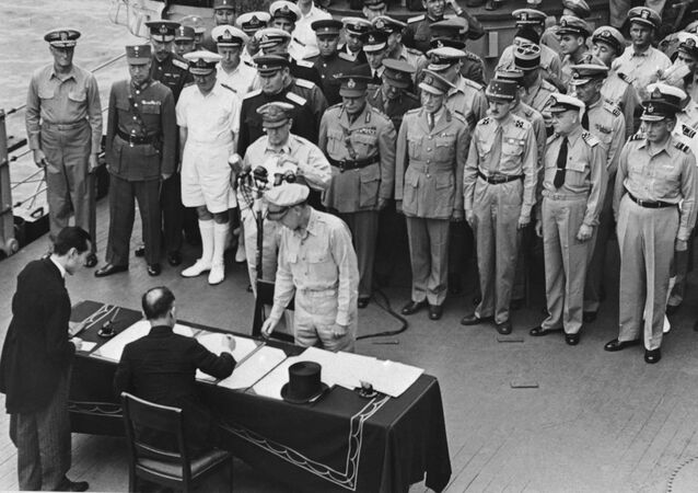 Mamoru Shigemitsu signs the unconditional surrender papers for Emperor Hirohito, thus committing Japan to accept the Potsdam Declaration.