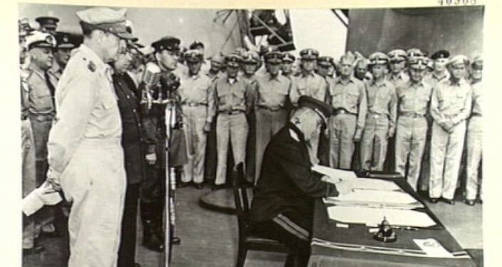 Lieutenant-General Derevyanko representing Union of Soviet Socialist Republics signs the instrument of surrender.
