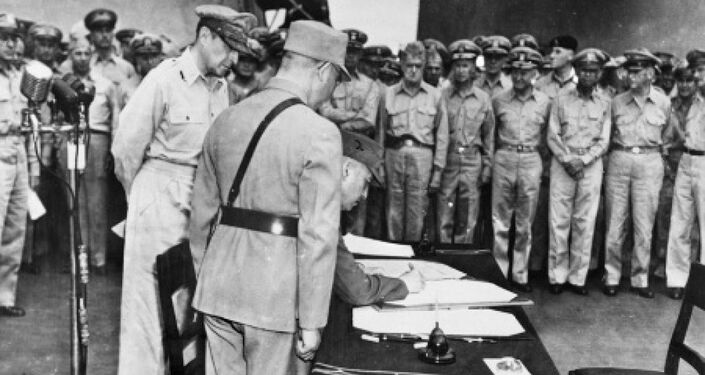 General Hsu Yung-Chang, representing Republic of China, signs the instrument of surrender.
