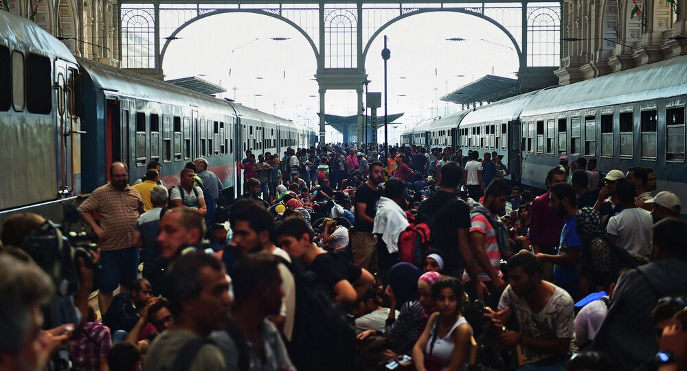 Migrants and refugees crowd the platforms at the Keleti (eastern) railway station in Budapest on September 1, 2015.