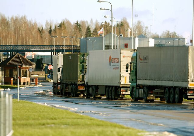 Trucks wait at the border crossing of Terehova in Latvia to enter Russia