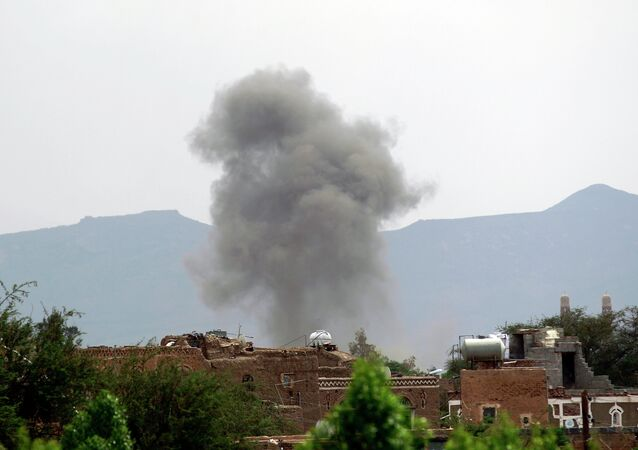 Smoke billows from the military college in the Yemeni capital, Sanaa, during a Saudi-led coalition air strike on September 2, 2015.
