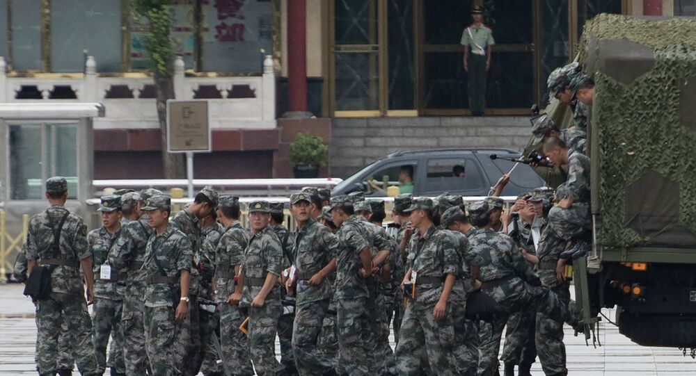 Chinese military arrive in Tiananmen Square to check shops around the square in Beijing