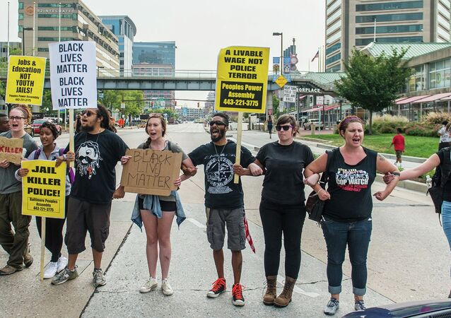Protesters block traffic on Pratt Street as protests moved into the street on the first day of pretrial motions for six police officers charged in connection with the death of Freddie Gray in Baltimore, Maryland September 2, 2015