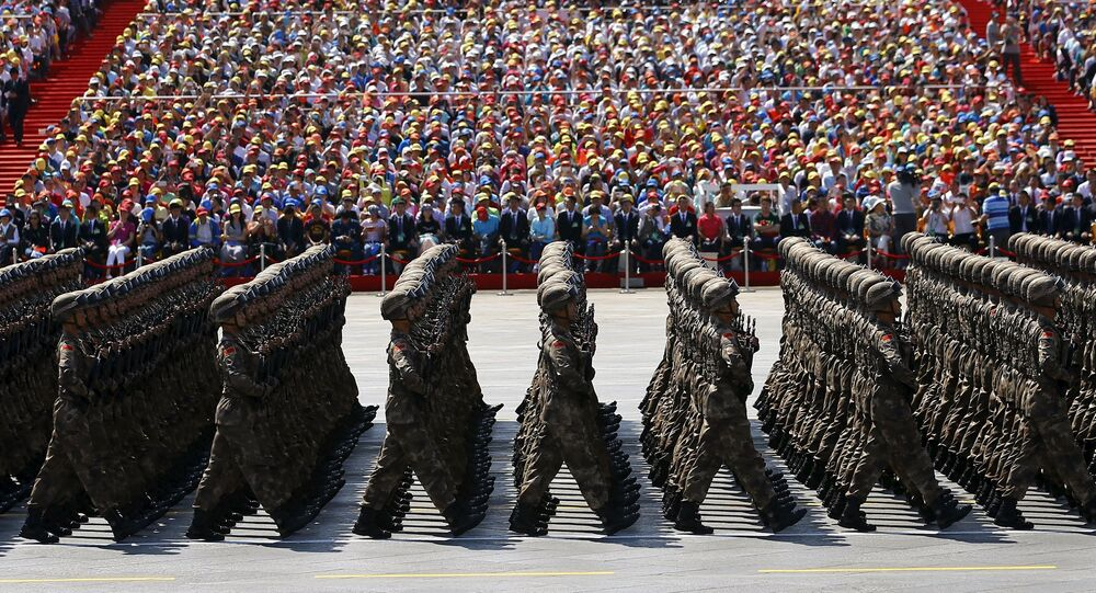 Soldiers of China's People's Liberation Army (PLA) march during the military parade to mark the 70th anniversary of the end of World War Two, in Beijing, China, September 3, 2015