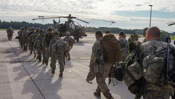 Paratroopers of 1st Battalion, 503rd Infantry Regiment, 173rd Airborne Brigade depart Lielvarde Airbase (NATO), Latvia. File photo - Sputnik International