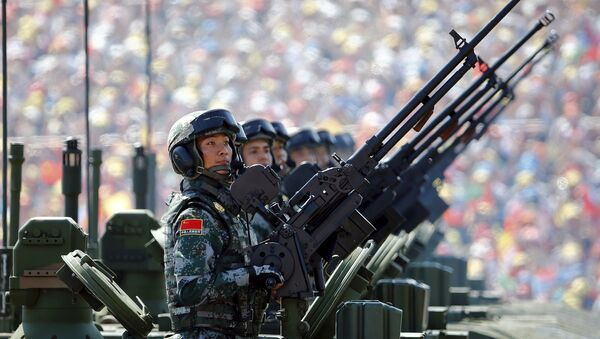 Soldiers of the People's Liberation Army (PLA) of China arrive on their armoured vehicles at Tiananmen Square during the military parade marking the 70th anniversary of the end of World War Two, in Beijing, China, September 3, 2015 - Sputnik International