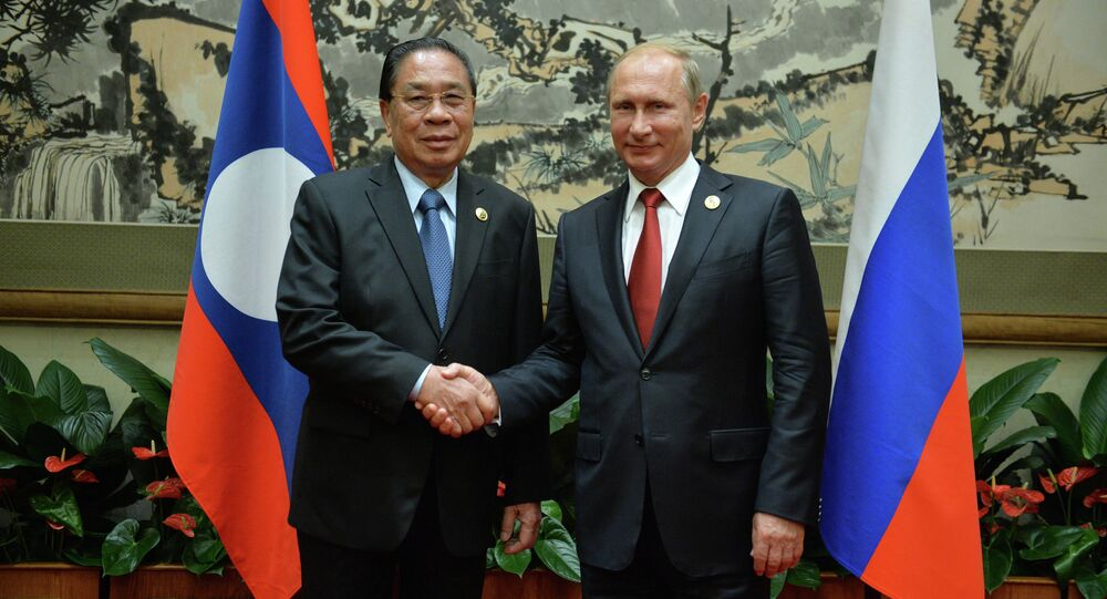 September 3, 2015. Russian President Vladimir Putin, right, and President of the People's Democratic Republic of Laos Choummaly Sayasone meet at the Diaoyutai residence in Beijing.