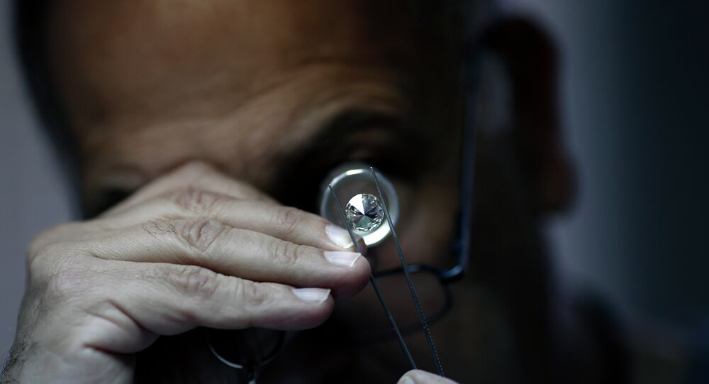 An Israeli diamonds buyer checks the quality of a diamond during the International Diamond Week (IDW) on February 10, 2015 in the Israeli city of Ramat Gan, east of Tel Aviv.