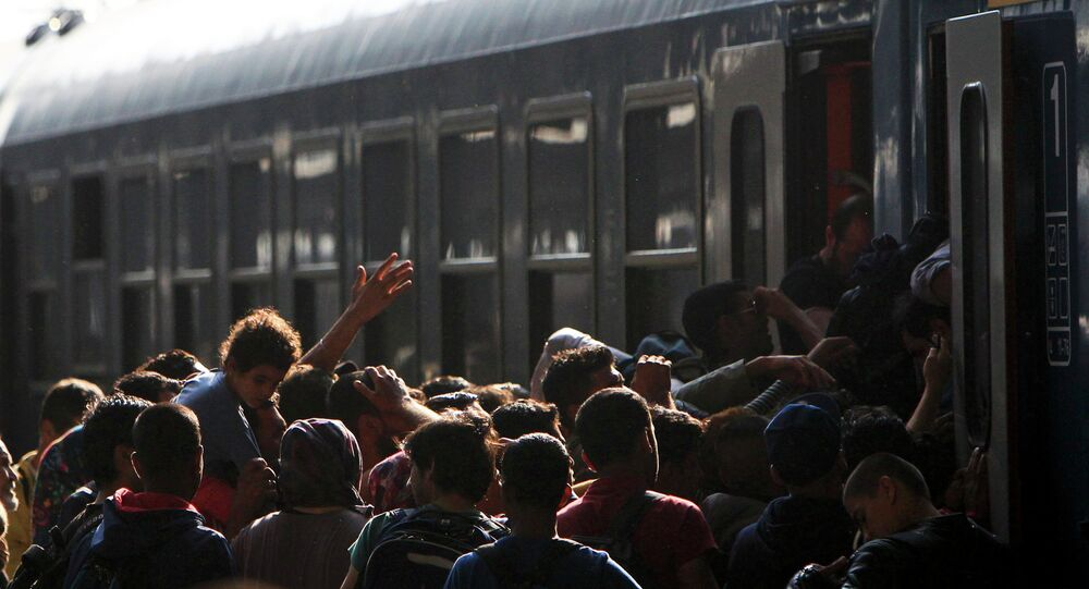 Migrants storm into a train at the Keleti train station in Budapest, Hungary, September 3, 2015 as Hungarian police withdrew from the gates after two days of blocking their entry