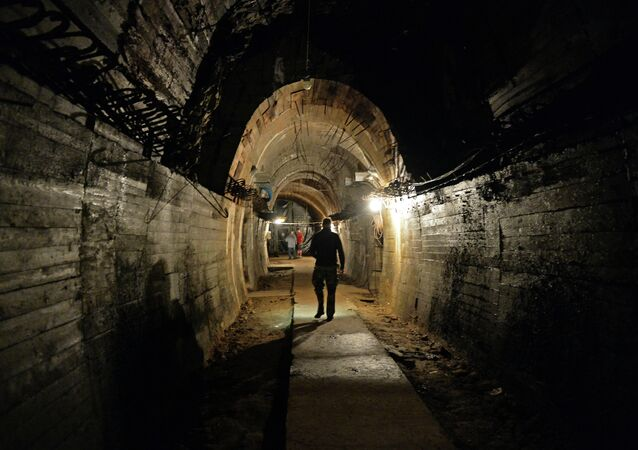 Men walk in underground galeries, part of Nazi Germany Riese construction project under the Ksiaz castle in the area where the Nazi gold train is supposedly hidden underground, on August 28, 2015