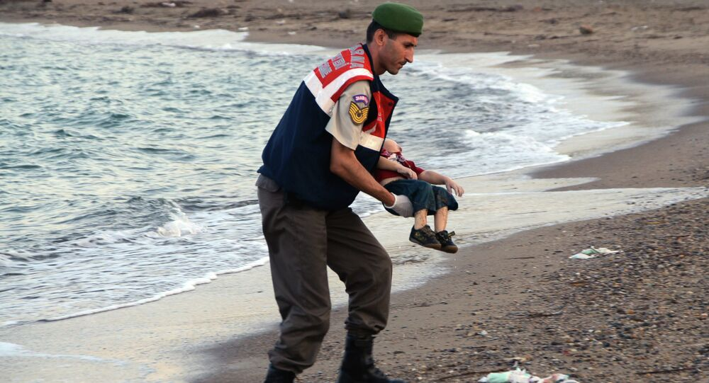 A migrant child's dead body lies off the shores in Bodrum, southern Turkey, on September 2, 2015 after a boat carrying refugees sank while reaching the Greek island of Kos.