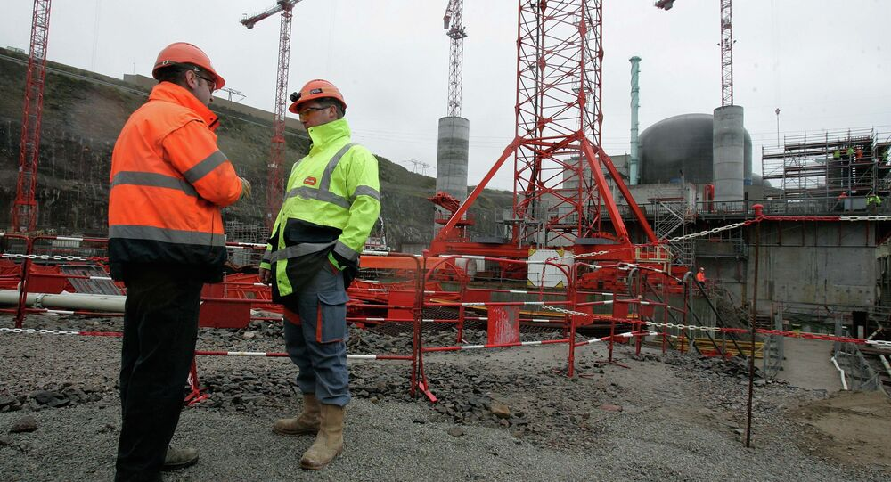 Workers are seen on a construction site of France's first new generation nuclear reactor in Flamanville, northwestern France, Friday, Feb. 6, 2009. The new so-called European Pressurized Reactors (EPR) plant on the Normandy coast, will be operational in 2012.