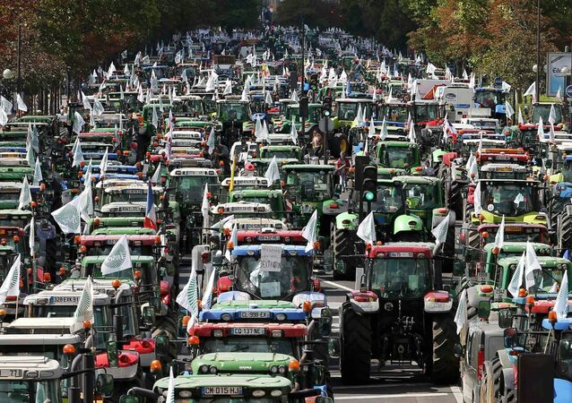 French farmers converge on the Place de la Nation square, driving their tractors on the Cours de Vincennes in Paris, France, September 3, 2015