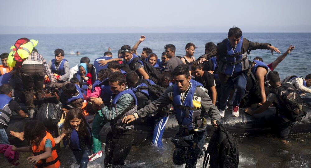 Syrian refugees jump off a dinghy as they arrive on the Greek island of Lesbos September 3, 2015