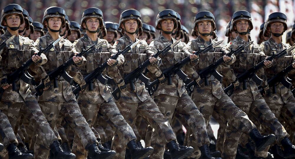 Chinese troops march during the military parade marking the 70th anniversary of the end of World War Two, in Beijing, China, September 3, 2015