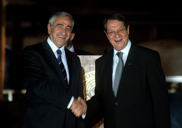 Cypriot President Nicos Anastasiades (R) shakes the hand of Turkish Cypriot President of the self-proclaimed Turkish Republic of Northern Cyprus (TRNC), Mustafa Akinci, following a UN-sponsored meeting at Ledra palace on May 11, 2015