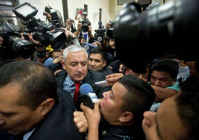 Guatemala's President Otto Perez Molina arrives to court to face corruption charges, after submitting his resignation in Guatemala City, Thursday, Sept. 3, 2015.