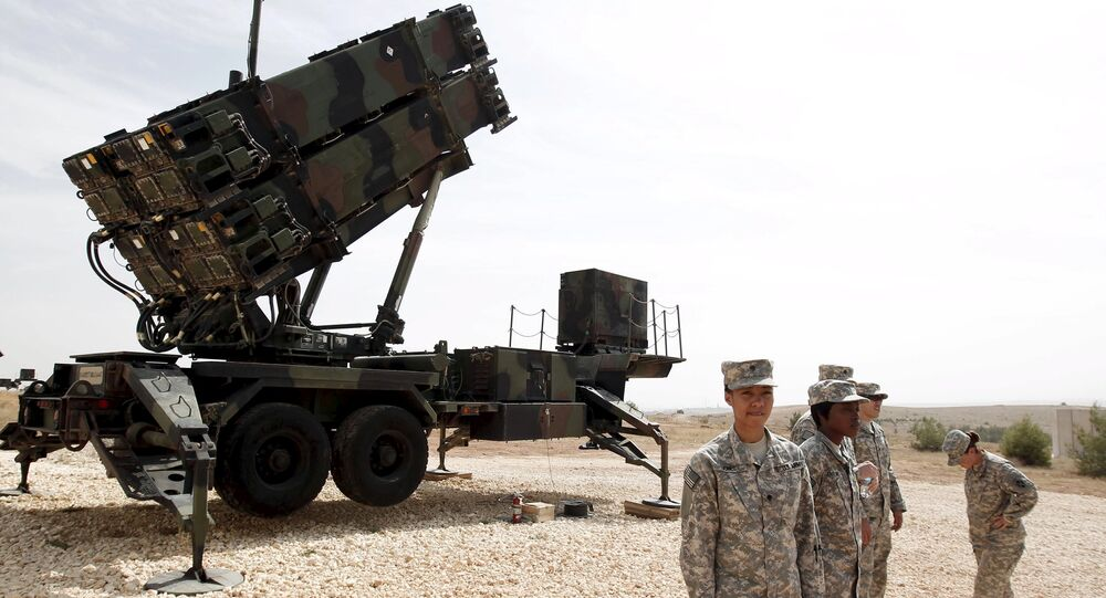 U.S. soldiers stand beside a U.S. Patriot missile system at a Turkish military base in Gaziantep, southeastern Turkey, in this October 10, 2014 file photo