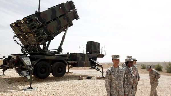 U.S. soldiers stand beside a U.S. Patriot missile system at a Turkish military base in Gaziantep, southeastern Turkey, in this October 10, 2014 file photo - Sputnik International
